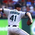 Charlie Furbush, of South Portland, throws a pitch against the Texas Rangers last season. The Seattle Mariners have sent Furbush to AAA Tacoma.