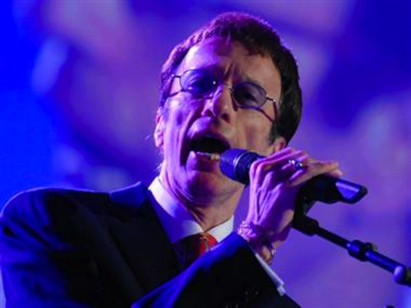 Bee Gees singer Robin Gibb, above, has awaken from a 12-day coma.