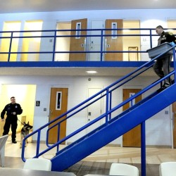 Cumberland County Jail officials conduct a search for contraband. The Jail faces a $600,000 shortfall by the end of June and is considering shuttering its pre-release center, closing sections of the jail and sending inmates back to their home counties.