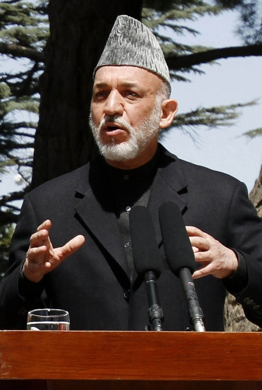 President Hamid Karzai condemned photos of troops with the remains of suicide bombers.