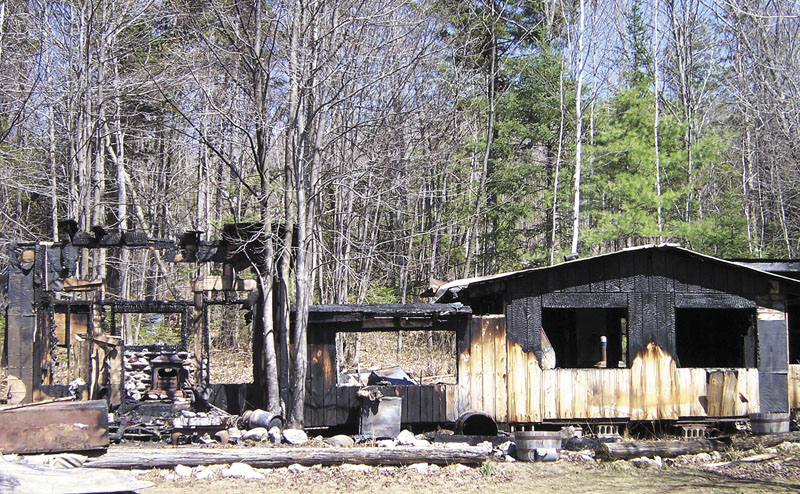 CABIN IN THE WOODS: Sparks from a chimney caused a grass fire Thursday that destroyed a wood cabin home in Wilton built by Larry Bisbee, a man known for hosting free country music concerts on the property.