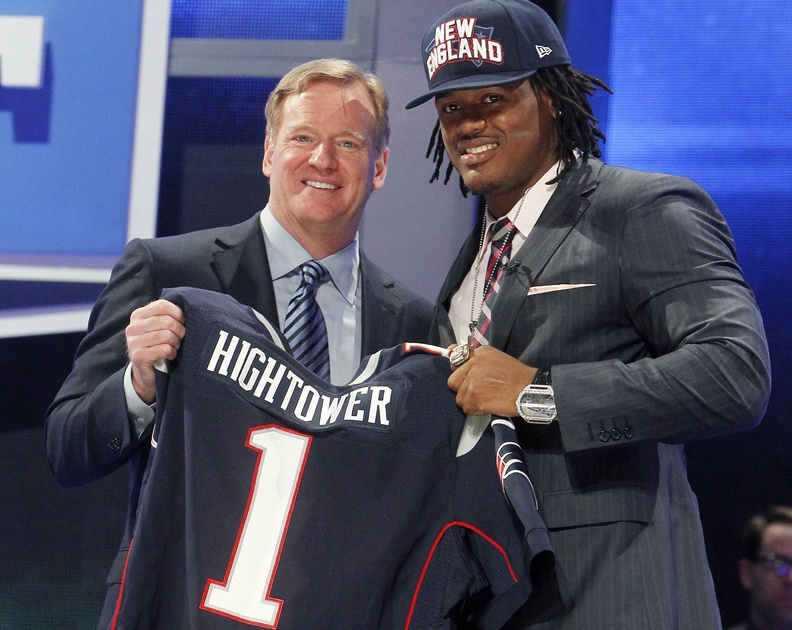Alabama's Dont'a Hightower, right, poses for photographs with NFL Commissioner Roger Goodell after being selected 25th overall by the New England Patriots in the first round of the NFL football draft on Thursday.