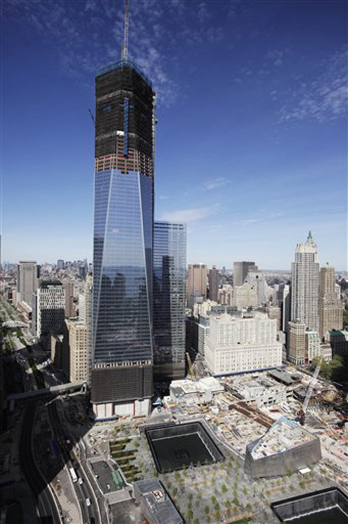 An April 17 photo of One World Trade Center, as it rises above the lower Manhattan skyline and the National September 11 Memorial, lower right, in New York.