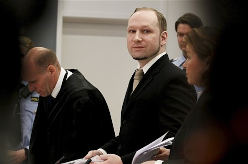 Accused Norwegian Anders Behring Breivik arrives at the courtroom, in Oslo, Norway, Tuesday April 17, 2012. The anti-Muslim fanatic who admitted to killing 77 people in a bomb-and-shooting massacre is set to take the stand in his terror trial. Anders Behring Breivik will have five days to explain why he set off a bomb in Oslo's government district, killing eight, and then gunned down 69 at a Labor Party youth camp outside the Norwegian capital. (AP Photo/Heiko Junge/Scanpix Norway, Pool)