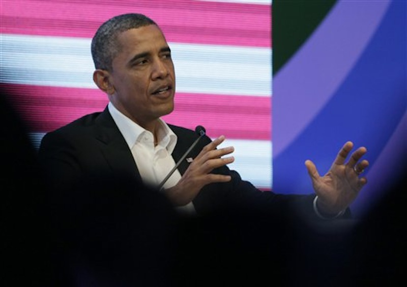 President Barack Obama participates in a three-way conversation with Brazil's President Dilma Rousseff and Colombia's President Juan Manuel Santos, not pictured, at the CEO Summit of the Americas, in Cartagena, Colombia, Saturday April 14, 2012. Regional business leaders are meeting parallel to the sixth Summit of the Americas which brings together presidents and prime ministers from Canada, the Caribbean, Latin America and the U.S. (AP Photo/Carolyn Kaster)