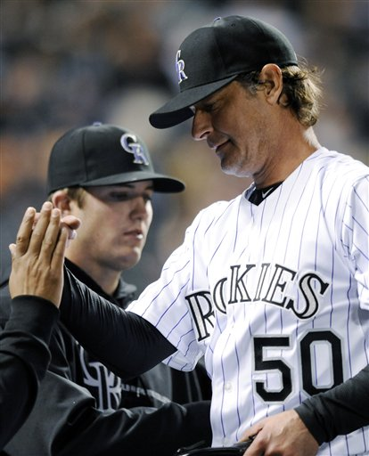 Colorado Rockies starting pitcher Jamie Moyer is congratulated by teammates in the sixth inning of a baseball game against the San Diego Padres on Tuesday in Denver. The Rockies won 5-3.