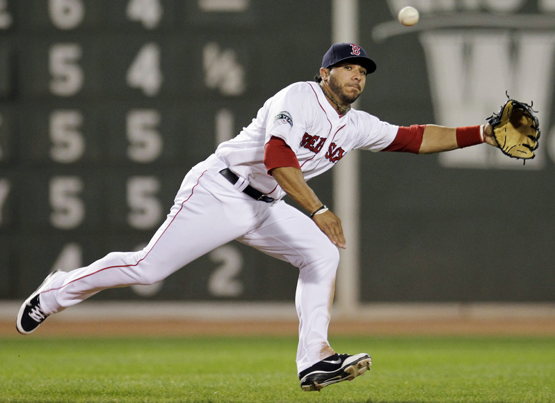 Boston Red Sox shortstop Mike Aviles cannot make a play on a single by Texas Rangers' Nelson Cruz during the third inning tonight at Fenway Park in Boston.