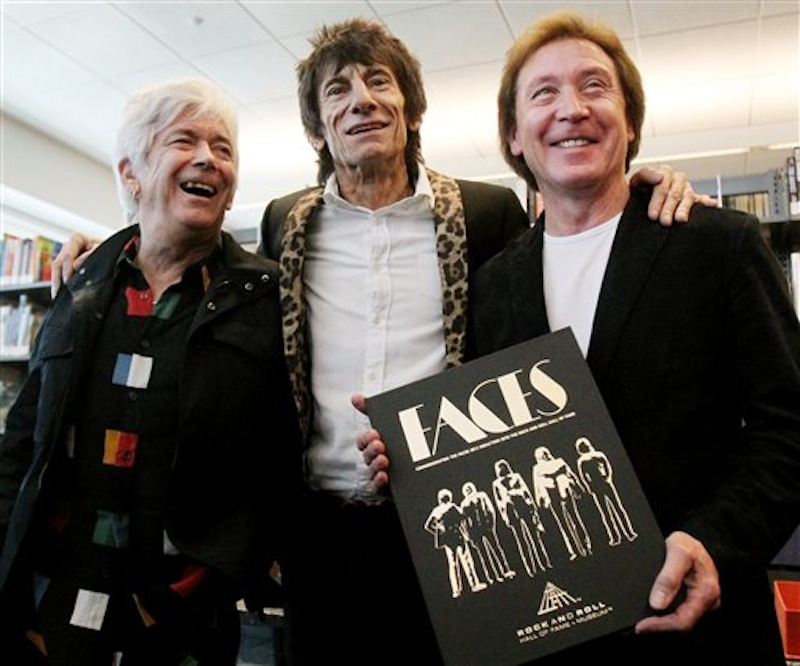 Members of the Faces rock group Ian McLagan, left, Ronnie Wood, center, and Kenney Jones pose with their book