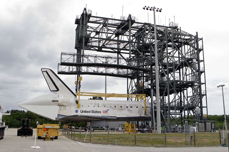 Space shuttle Discovery waits at the Mate-Demate structure to be to be mounted atop a 747 carrier jet, not pictured, at the Kennedy Space Center, Saturday, April 14, 2012, in Cape Canaveral, Fla. Discovery will be transported to the Smithsonian National Air and Space Museum in Washington on Tuesday, April 17.