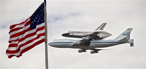 The space shuttle Discovery soars past Capitol Hill in Washington today, atop a special NASA Boeing 747 jet.