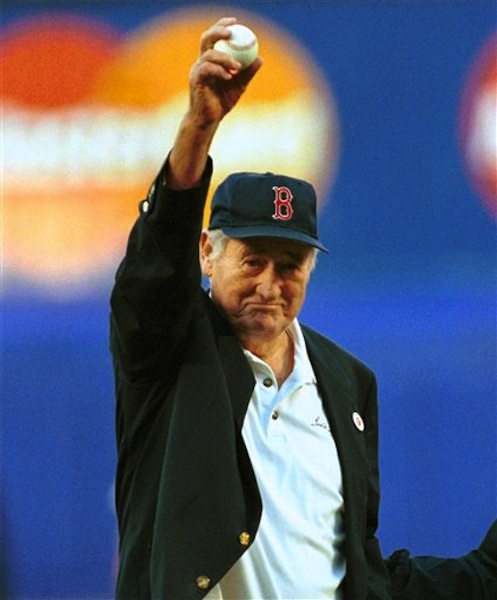 In this June 11, 1999 file photo, Boston Red Sox Hall of Famer Ted Williams winds up to throw out the ceremonial first pitch before a baseball game between the Red Sox game and the New York Mets in New York. (AP Photo/Bill Kostroun, File)