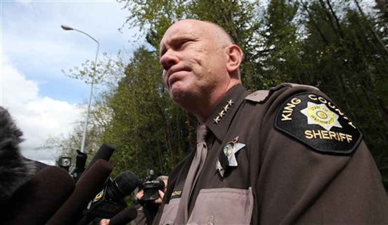 King County Sheriff Steve Strachan speaks with media members about police finding the bunker of man suspected of killing his wife and daughter days earlier, Friday, April 27, 2012, in North Bend, Wash. King County deputies say there's someone inside the deep woods bunker of the gun-toting survivalist suspected of the killings and holing up for days in the Cascade foothills east of Seattle. The underground bunker is surrounded by police, who have pumped gas inside. Sgt. Cindi West says photos found in Peter A. Keller's home helped them find the bunker Friday morning. (AP Photo/Elaine Thompson)