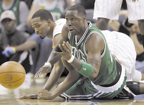 Boston's Mickael Pietrus and Charlotte's Derrick Brown chase a loose ball during the second half Sunday in Charlotte, N.C.