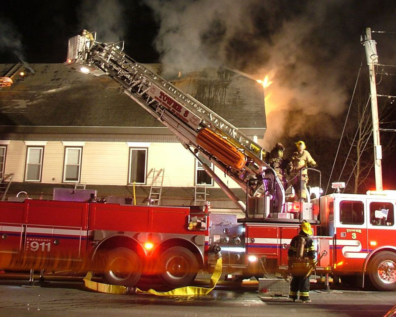 The scene last night as fire crews fight a four-alarm fire in Gorham at the corner of routes 114 and 25.