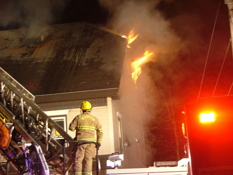 A Windham firefighter at the scene of the fire at the Gorham House of Pizza last night.