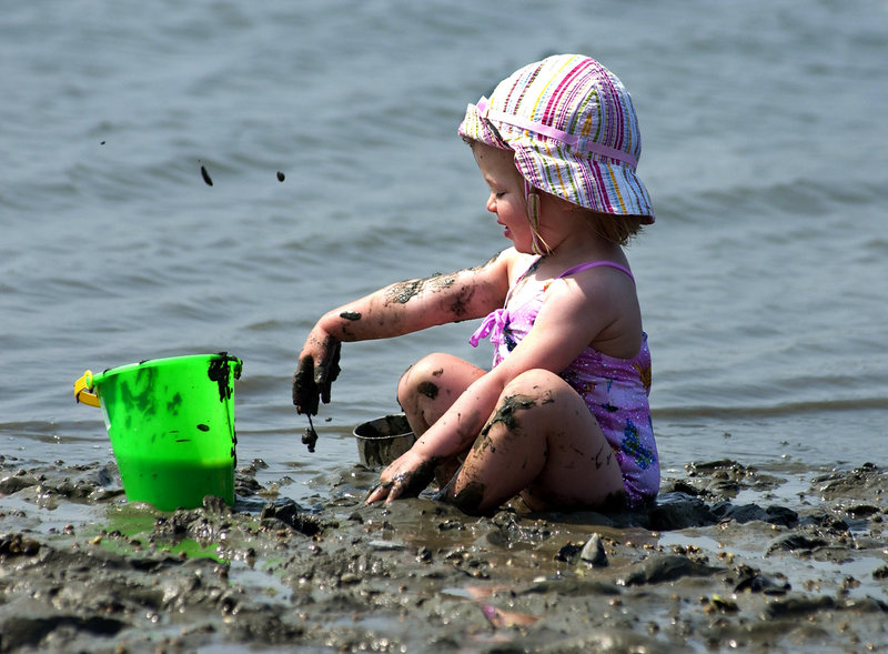A toddler makes the most of some mud on an outing to Mackworth Island.