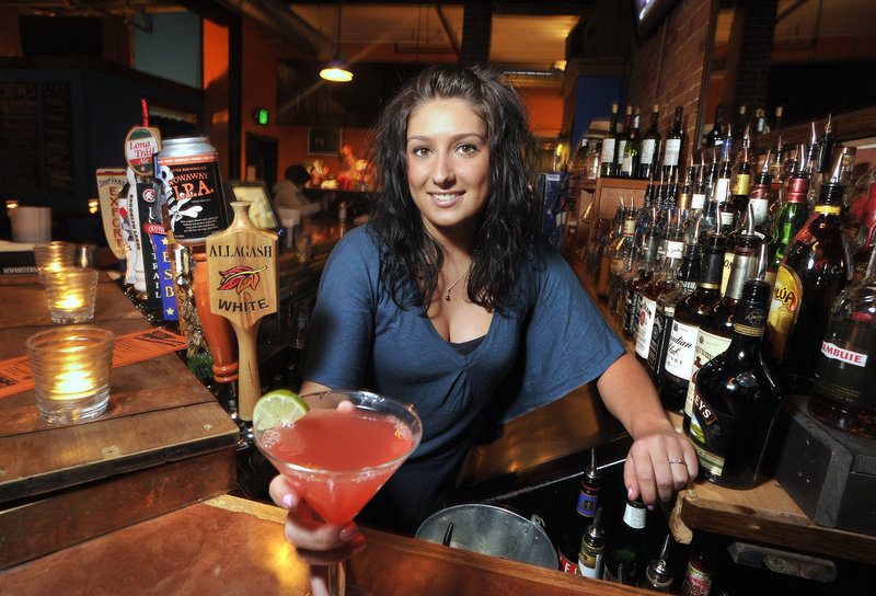 Heather Piela tends bar at Empire Dine & Dance, which offers something extra to do most nights.