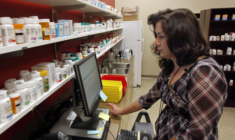 "Terry Kroh, pharmacy director at Duquesne University's Center for Pharmacy Services, fills a prescription at the Pittsburgh store, where the focus is solely on patient care. ""It's not a browse-the-aisles pharmacy,"" with soft drinks and candy for sale, said J. Douglas Bricker, Duquesne School of Pharmacy dean."