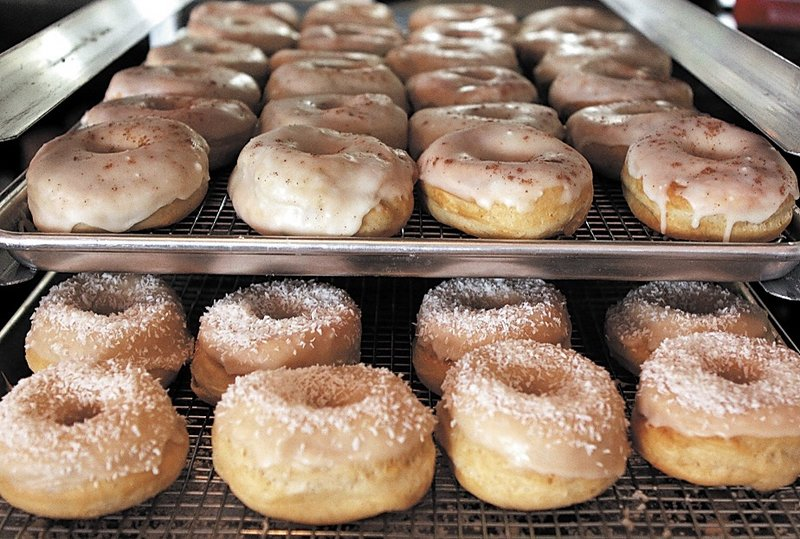 Dun-Well Doughnuts come in dozens of varieties, including root beer, tangerine, and a jelly doughnut with peanut butter icing.