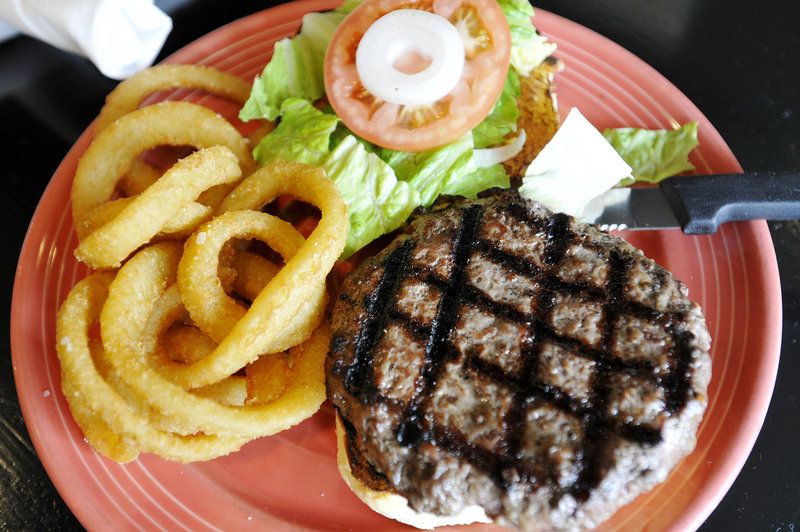 A burger and onion rings at Shays Grill Pub in Portland.