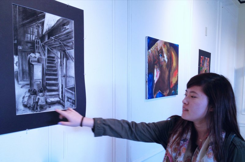 Yena Kang in Sturtevant Gallery on the Hebron Academy campus, where an exhibition of her work hangs.
