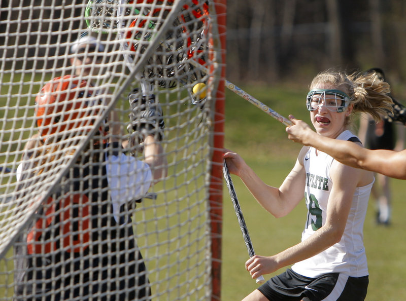 Martha Veroneau of Waynflete prepares to shoot Friday against North Yarmouth Academy goalie Mallory Ianno. Veroneau scored four goals, helping Waynflete to a 15-5 victory.