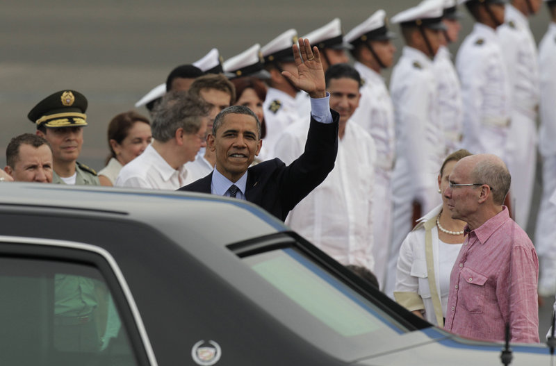President Obama arrives in Cartagena, Colombia, on Friday for the Summit of the Americas. At right is U.S. ambassador to Colombia Michael McKinley. Among the issues: South American leaders back Argentina's claim to the Falkland Islands, which the U.S. does not.