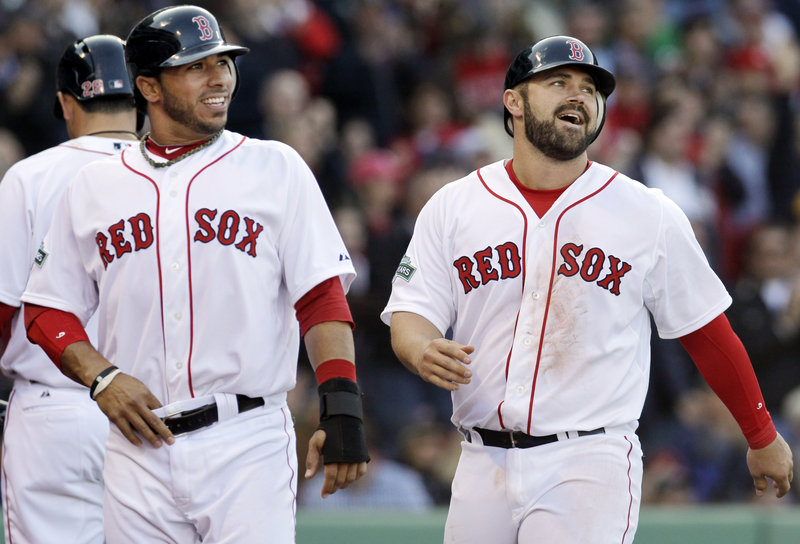 Mike Aviles, left, and Kelly Shoppach are all smiles after scoring on a Ryan Sweeney single – part of an eight-run eighth inning for the Red Sox.