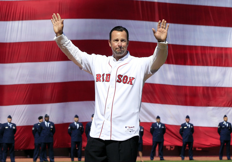 Tim Wakefield was part of the opening ceremonies Friday at Fenway Park, as was Jason Varitek. The two recently retired players returned to Fenway to throw out the first pitch before the 12-2 victory over Tampa Bay.
