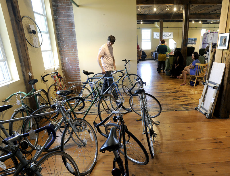 Andrew Erwin of South Portland checks out bikes at the new Flea-for-All market in Portland on Saturday.