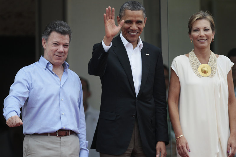 President Obama is flanked by Colombian President Juan Manuel Santos, left, and Santos' wife, first lady Maria Clemencia Rodriguez, in Cartagena, Colombia, on Saturday.