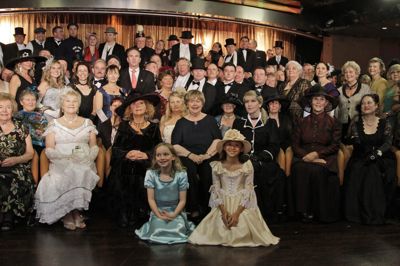 Passengers in costume pose Friday for a picture following a reception on the MS Balmoral Titanic memorial cruise.
