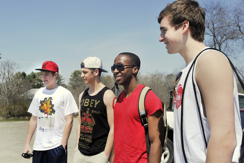 South Portland High School students, from left, Trevor Fenwick, Nick Fagone, Sacre Bahati and Josh McDuffy, said Monday they were unaware of the proposed parking fee increase at Higgins Beach. They said they would now think twice about paying for a parking spot there.