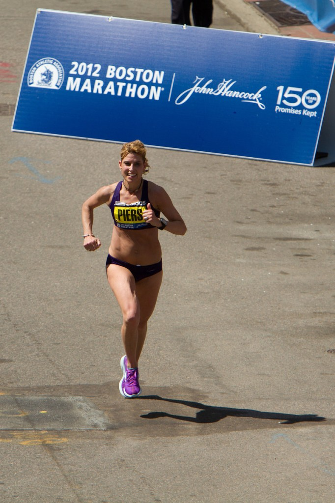 Still smiling after 26 miles, Falmouth's Sheri Piers is the first American woman across the finish line in the 116th Boston Marathon on Monday. Piers, 40, was the second female masters runner and the 10th woman overall.