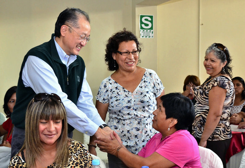 Jim Yong Kim, left, greets people at a cultural center in Lima, Peru, on Sunday. Kim, the president of Dartmouth College, was chosen president of the World Bank on Monday.