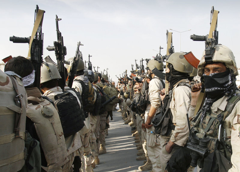 Afghan special forces regroup after a gunbattle near the Afghan parliament in Kabul on Monday.