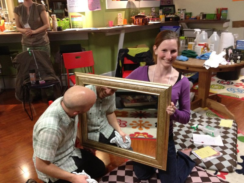 Joe Walsh, owner of Green Clean Maine, cleans a mirror at a meeting of the Holistic Moms Network in April. Erin Moulton of Windham assists with the demonstration. Walsh uses only environmentally friendly cleaners in his business.