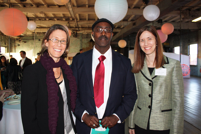 Immigrant Legal Advocacy Project board President Lori Dwyer, translator Alain Jean Claude Nahimana and board member Jennifer Archer.