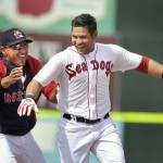 Ronald Bermudez gets chased by teammate Ryan Dent after hitting a winning single off the left-field wall in the bottom of the ninth inning Wednesday at Hadlock Field.