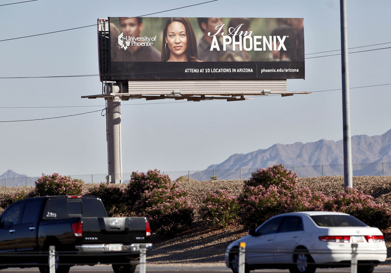 A University of Phoenix billboard from 2009 seeks students for the for-profit college in Chandler, Ariz. Those colleges use a large portion of their revenues for recruiting students.
