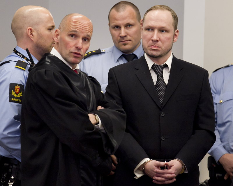 Anders Behring Breivik, right, stands with lawyer Geir Lippestad on the third day of his trial Wednesday in Oslo, Norway. Breivik is charged with killing 77 people in 2011.
