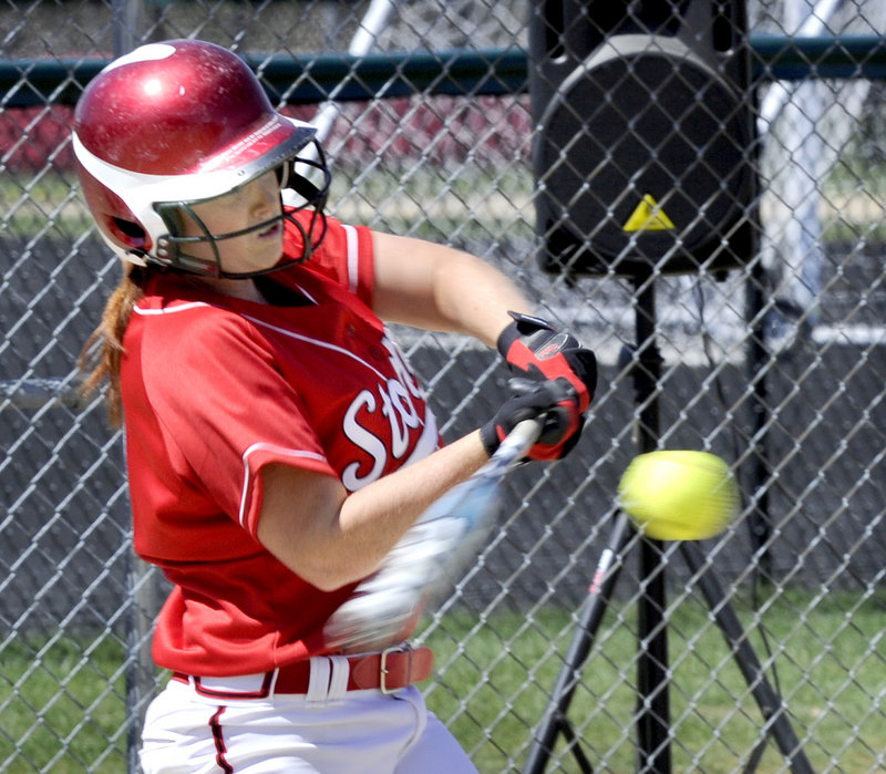 Mo Hannan connects for a three-run homer that helped Scarborough finish off a 13-0 victory over Biddeford in a softball season opener Thursday.