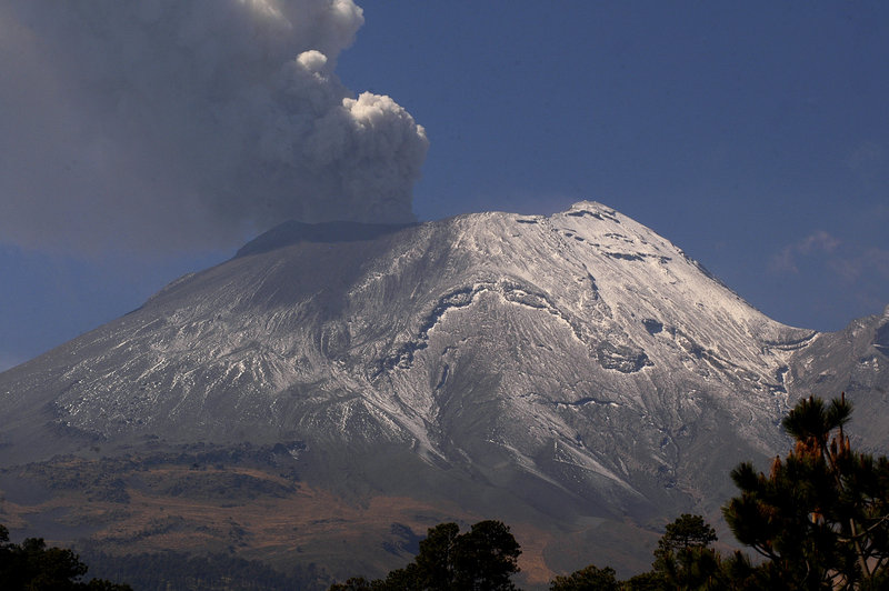 A plume of ash and smoke rises from the Popocatepetl volcano as seen from the town of Santiago Xalizintla in Mexico. The volcano emitted a low-pitched roar early Friday.