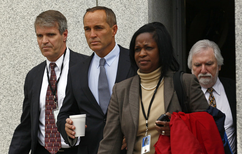 Andrew Young, second from left, former aide to John Edwards, leaves federal court in Greensboro, N.C., on Monday. Young and Edwards were so close that when Edwards got his mistress pregnant in 2007, the married Young publically claimed paternity of his boss' unborn child.