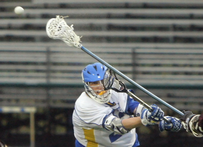 Jack Cooleen of Falmouth takes a shot during his team's 15-7 boys' lacrosse win Monday night against Greely. The Yachtsmen raced to an 8-0 lead in the first quarter and got goals from eight players, including two by Cooleen.