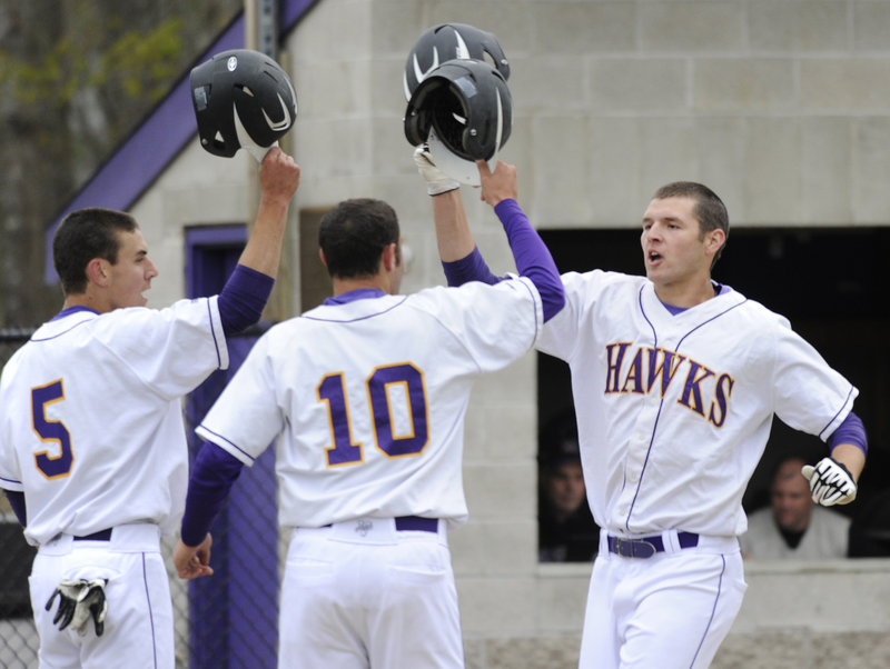 Jack Verrill, right, is congratulated by Luke Fernandes, left, and Matt Brenner after hitting a three-run homer Thursday during a five-run third inning for Marshwood. The Hawks went on to a 6-3 victory against Cheverus, the defending Class A state champion.
