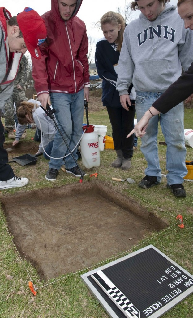 Assistant Professor Meghan Howey's anthropology class performs an archaeology dig on the site of the former Pettee House in Durham, N.H., in this April 9 photo provided by the University of New Hampshire.
