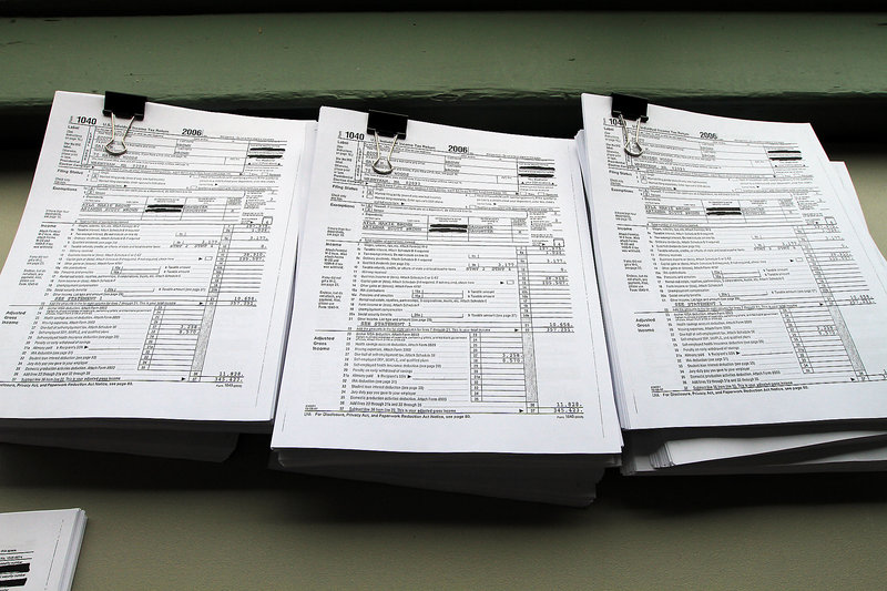 Documents showing the last six years of Republican U.S. Sen. Scott Brown's income tax forms are displayed in his South Boston headquarters Friday.
