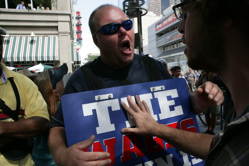 Tim Schultheis expresses his religious views in 2008 outside the Democratic National Convention in Denver. The host cities for this year's national political conventions are gearing up to provide security, but their state laws allow concealed weapons.