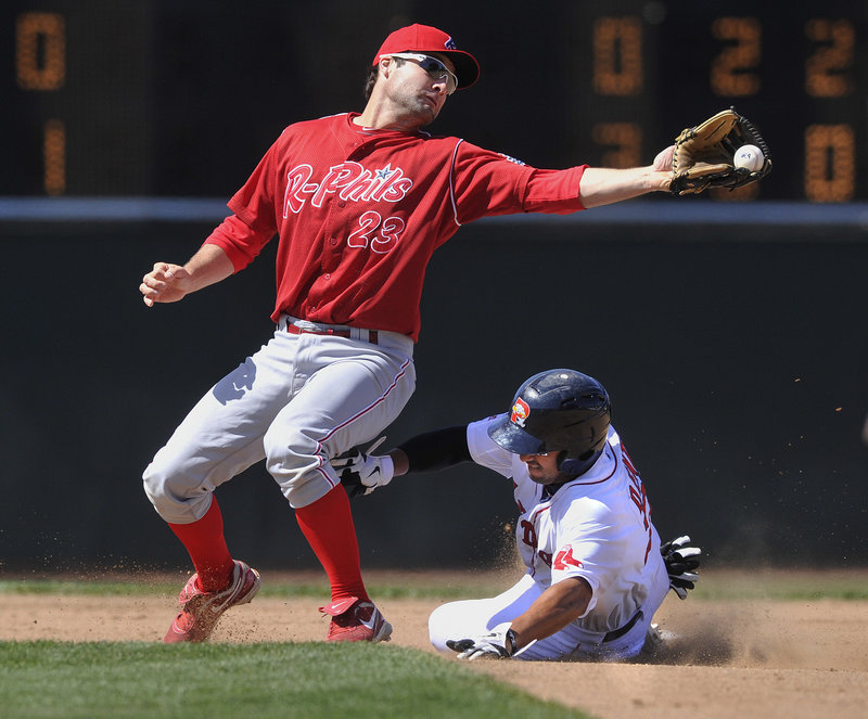 Reading's Tim Kennelly can't handle the throw as Portland's Ryan Dent slides safely into second base during their game Saturday. The Sea Dogs won 9-1 following a strong outing from rehabbing Red Sox pitcher Daisuke Matsuzaka.